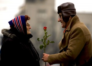 A man offers a rose to a woman to mark International Women's Day in Belgrade